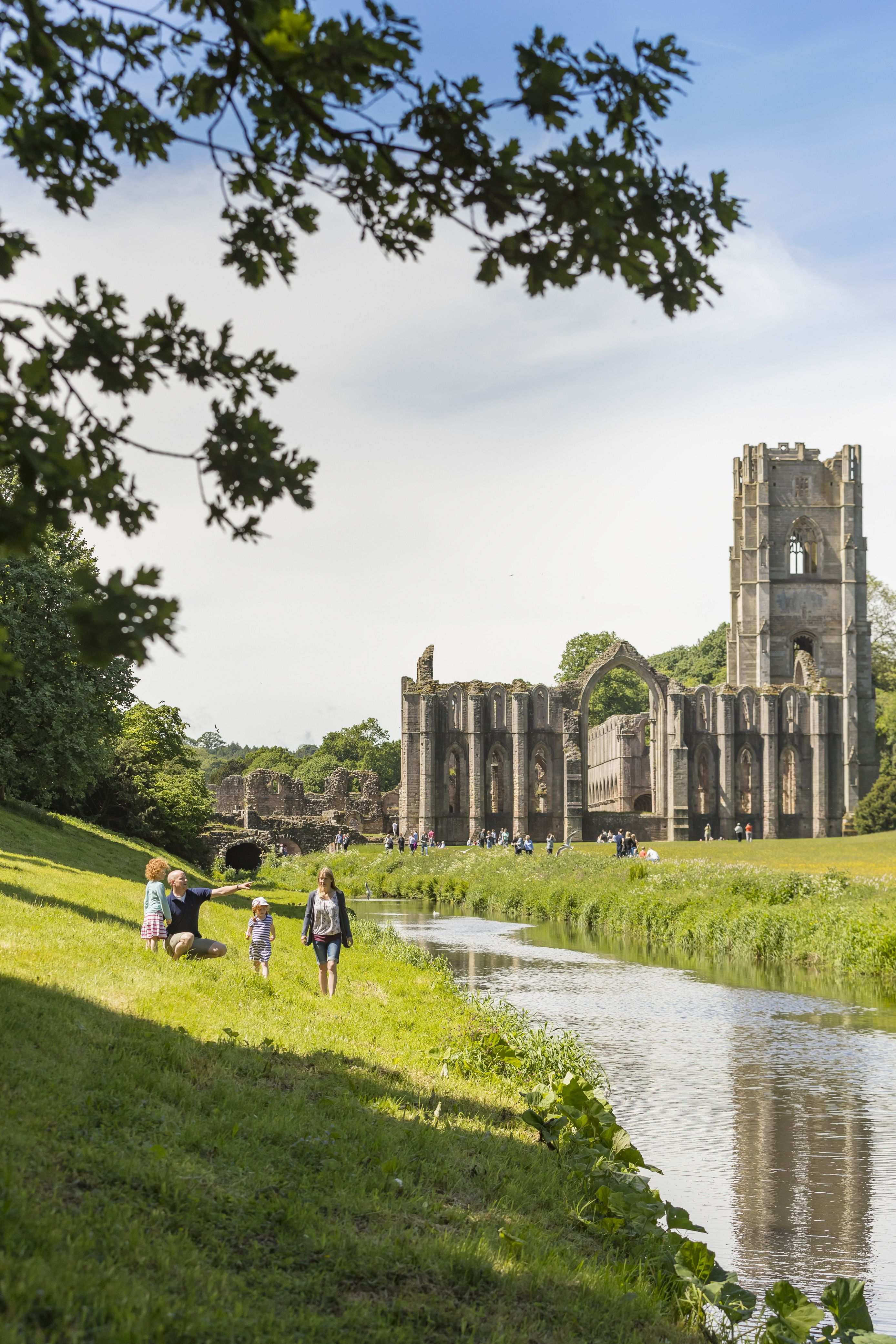 Visitors walking through the grounds of Fountains Abbey and Studley Royal Water Garden, North Yorkshire