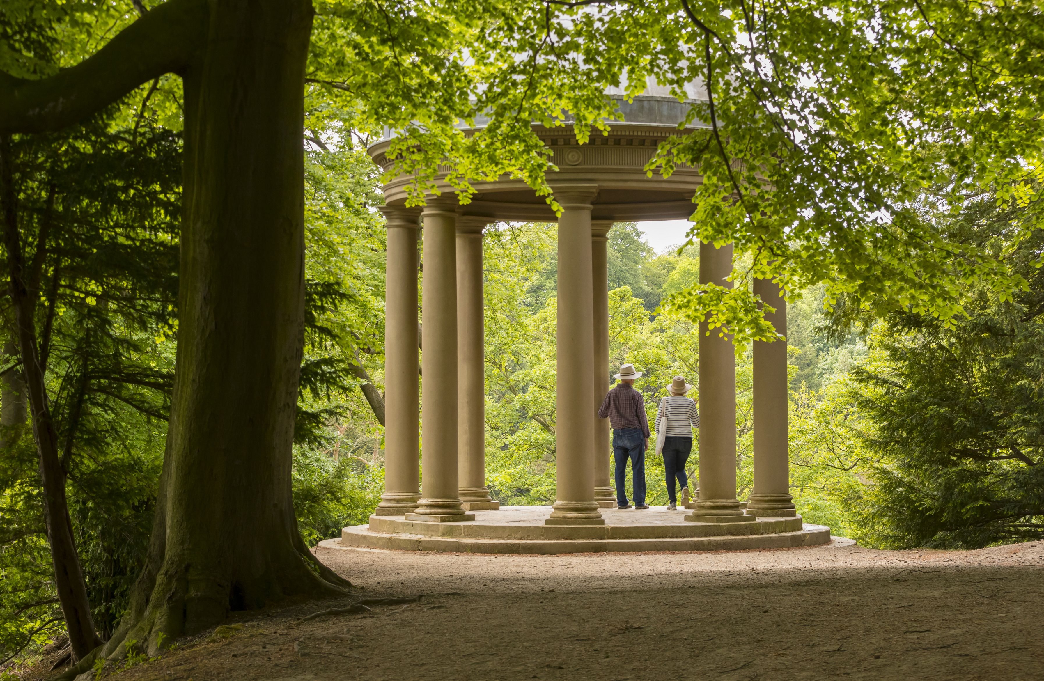 Visitors at the Temple of Fame in the grounds of Fountains Abbey and Studley Royal Water Garden, North Yorkshire